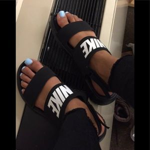 2 pairs of Nike sandals